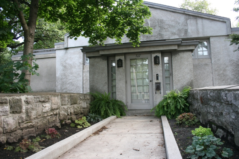 An entry to the 1915 Hugh Gilmore House designed by Francis Barry Byrne. It's located at 511 E. State Street.