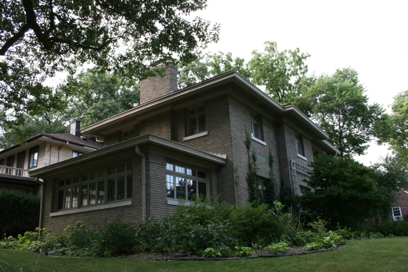 The 1920 George Romey House was designed by J.M. Felt & Co. with Prairie School influence.