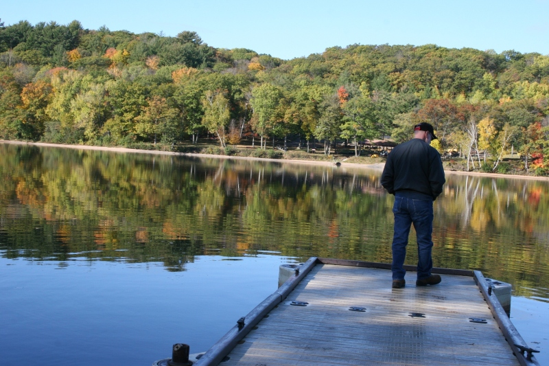 My husband on a dock at St. Croix Falls Lions Park along the St. Croix River.