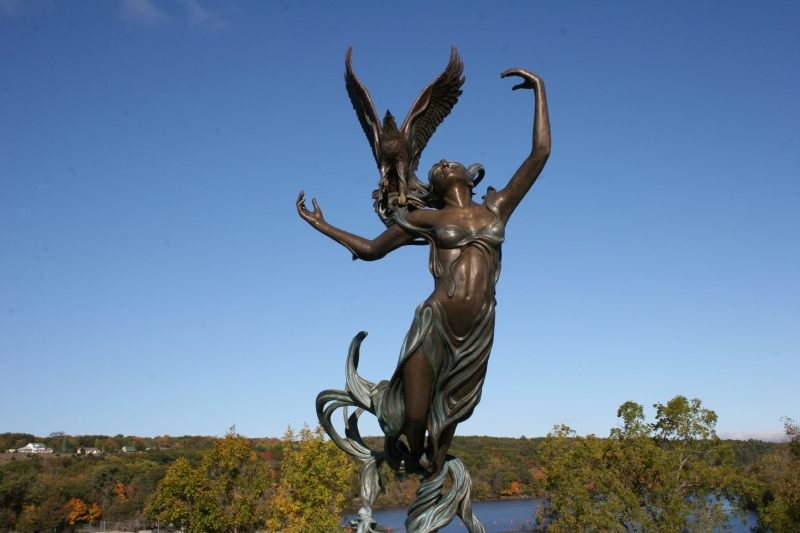 """""""River Spirit,"""" a bronze sculpture by local Julie Ann Stage, embodies the poetry and natural beauty of the St. Croix River Valley. The artwork was installed in 2007 and stands at a scenic overlook in downtown St. Croix Falls."""