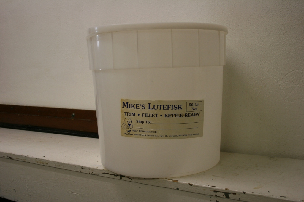 An empty lutefisk bucket from a previous supper.