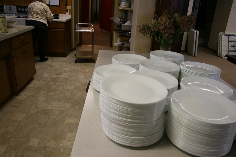 Plates are stacked on the kitchen counter.
