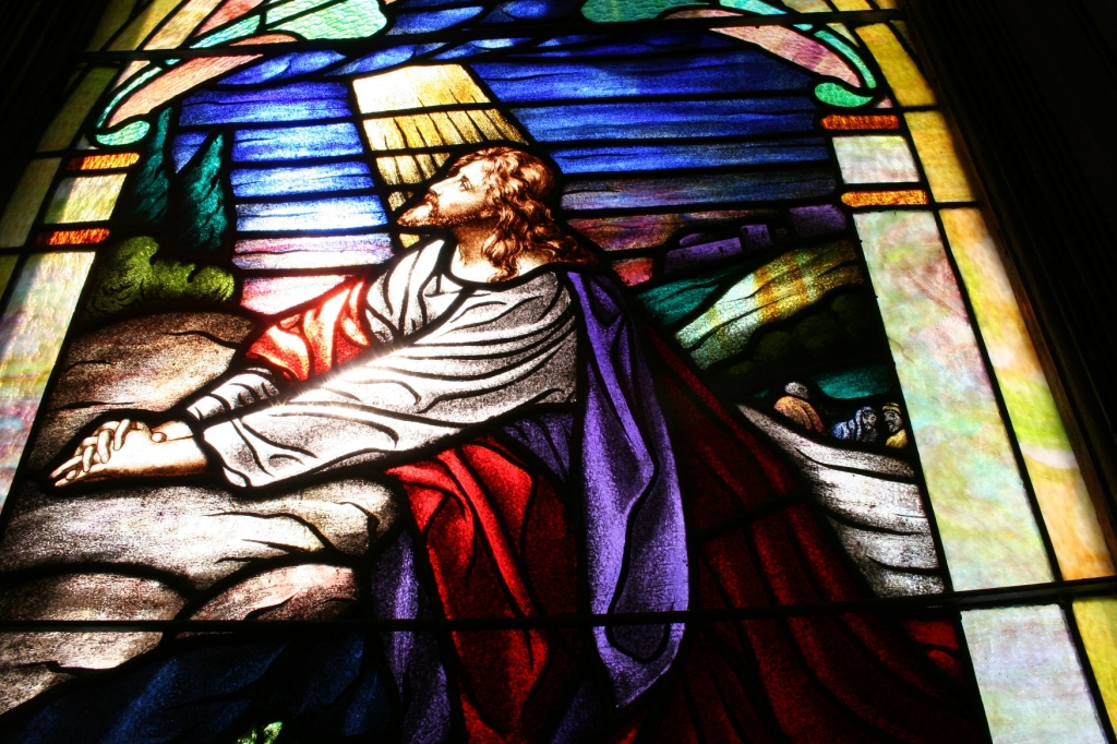 Beautiful stained glass windows grace the sanctuary.