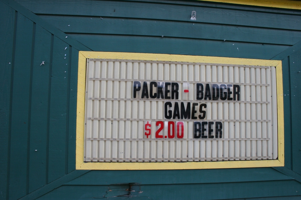 Wisconsinites love their Packers as evidenced by this sign on the corner Packers bar, painted green and gold.