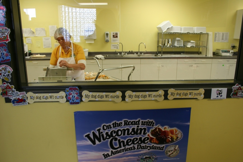 Customers can watch employees bagging cheese curds.