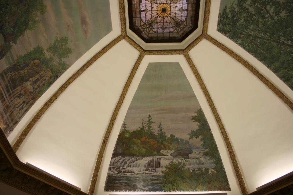 Rotunda murals depict the area's natural beauty.