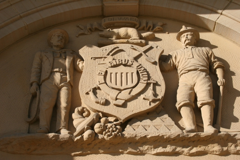 This beautiful stone sculpture rises above the front courthouse entry. Anyone know anything about the sculpture?