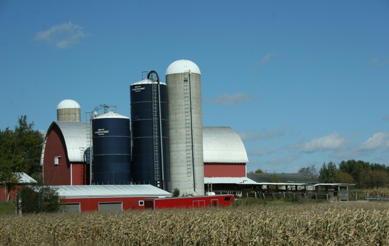 Rural, red barn and Harvestores