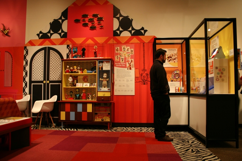 A museum visitor checks out the 1960s exhibit.