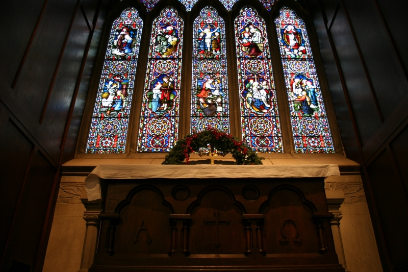 Looking up at the altar and the stunning stained glass windows above it.