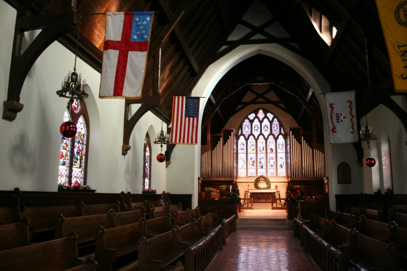 Inside the historic sanctuary, the pews face the aisle rather than the altar.