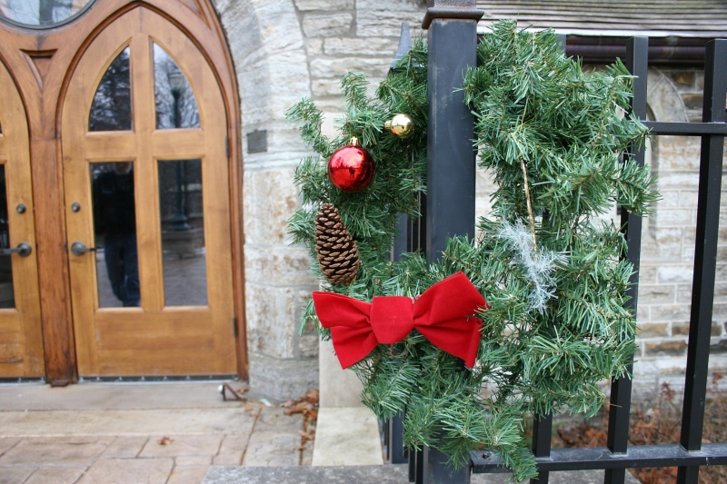 The exterior is tastefully and simply decorated for the holidays.
