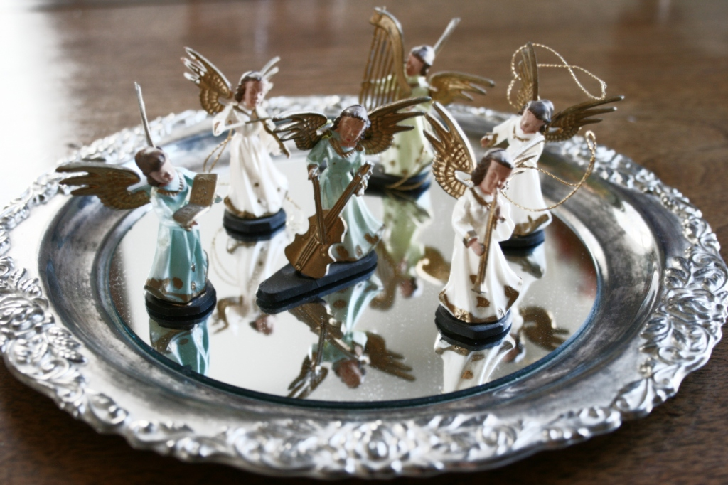 My oldest brother and I purchased this set of miniature plastic angels for our mom as a Christmas gift in the 1960s. Several years ago, my mom gave them back to me and I display them each Christmas. They are among my most treasured of holiday decorations.