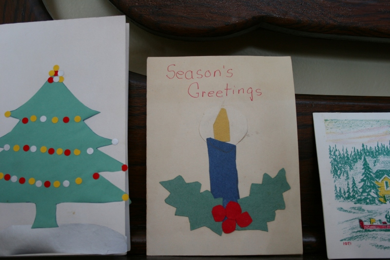 While going through a box of cards my mom had saved, I found several Christmas cards that I made as a child. This year I displayed those cards, along with a vintage card from Schwans