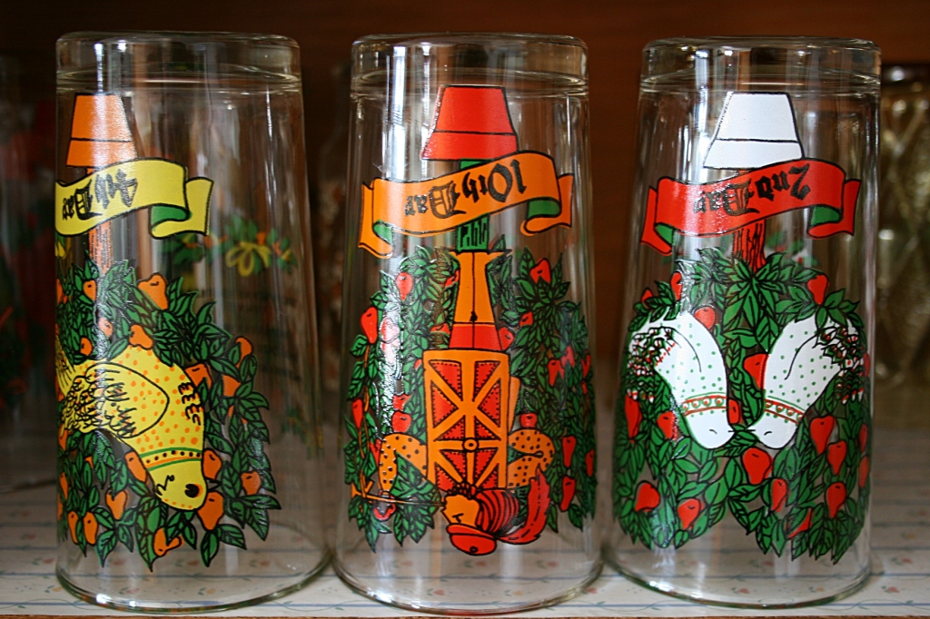 Come December, I swap out my regular vintage drinking glasses for the Twelve Days of Christmas glasses. These were gifted to me by the furniture store right across the street from the newspaper office where I worked in 1978 in Gaylord. Since then, I've acquired the same set of holiday glasses for each of my four children at garage sales and an antique shop.