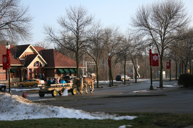 Free horse-drawn wagon rides were offered around downtown Faribault Saturday afternoon. Here the wagon, with Santa aboard, passes The Depot Bar and Grill.