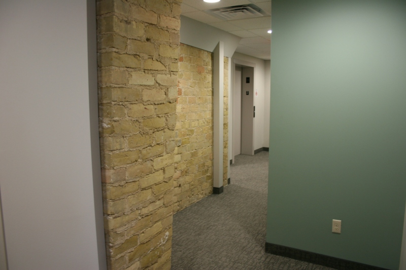 A maze of hallways, some featuring stone, lead to guest rooms.
