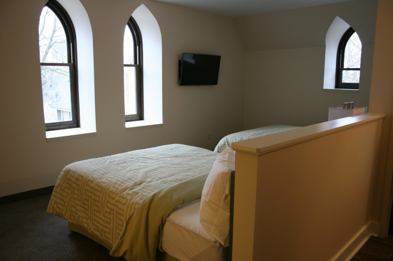 Church style windows add Old World charm to this guest room in the old part of The Inn.