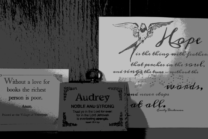 Inspirational quotes posted on my desk, on the shelf above my desktop screen.
