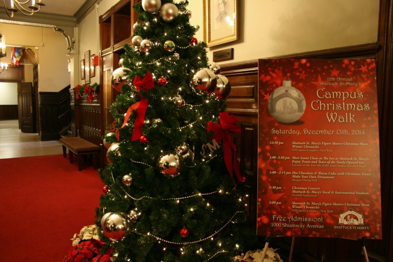 Inside Shumway Hall, a sign welcomes visitors to the annual Campus Christmas Walk.
