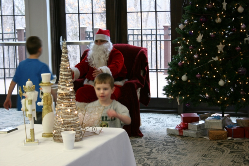 One boy headed for a treat after visiting Santa while another raced toward Santa's open arms at The Inn.
