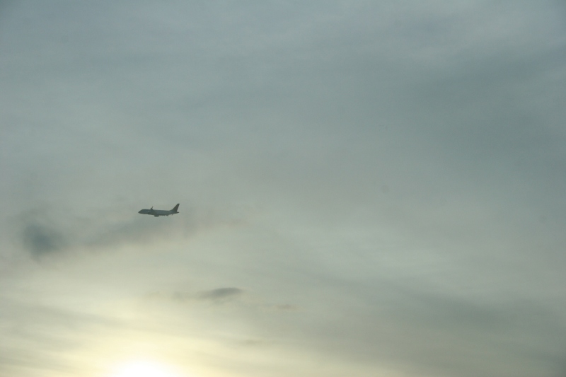A plane flies out of the Minneapolis-St. Paul International Airport.