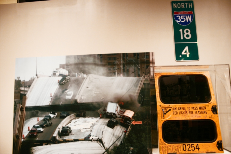 A section of the then now wow exhibit at the Minnesota History Center in St. Paul features the 35W bridge collapse. This image shows the collapsed bridge and the emergency exit door from a school bus that was on the bridge when it collapsed.