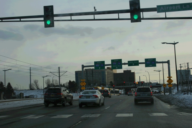 Vehicle traffic and light rail meet at this oddly configured intersection near the Minneapolis-St. Paul International Airport.