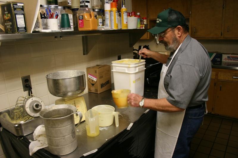 Bob Cross mixes pancake batter following his secret recipe.