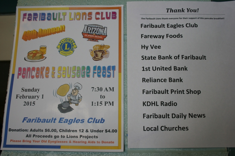 Signs advertise the event and thank sponsors.
