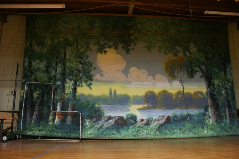 This massive WPA project painting hangs as a stage backdrop.