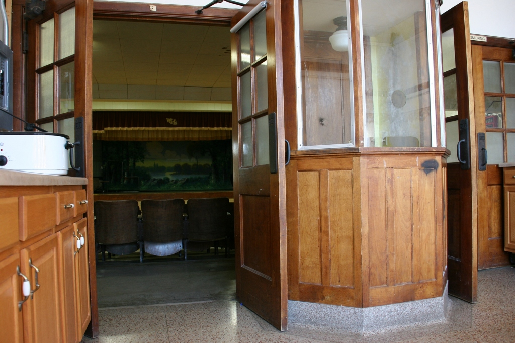 The original ticket booth remains just inside the front entry.