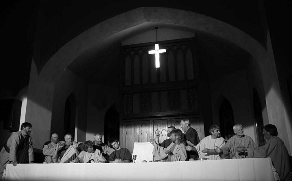 The cast of the 2012 The Last Supper Drama poses like the Leonardo da Vinci painting.