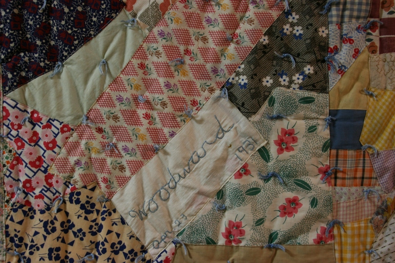 Beautiful handmade quilts are displayed.