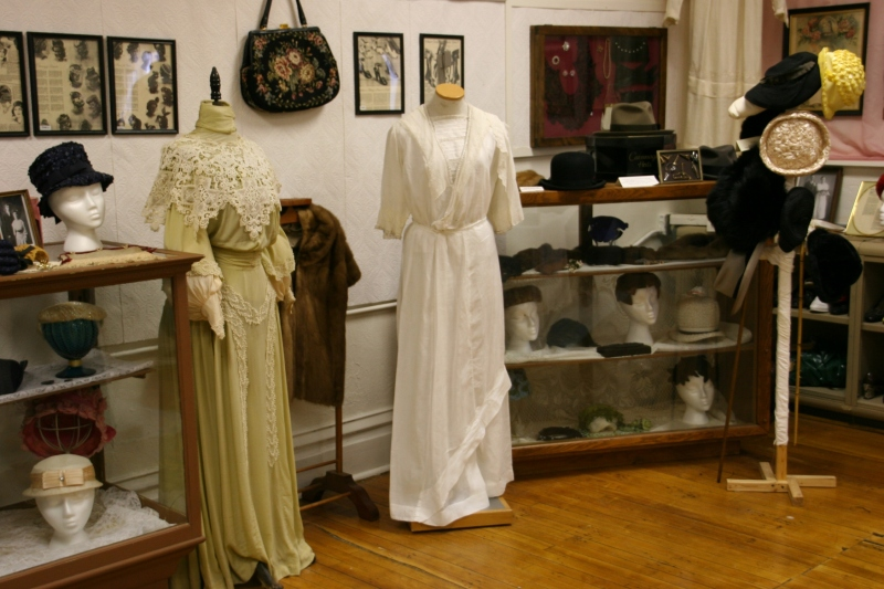 Clothing and sewing equipment from times past suggests how far a generation or two have come.
