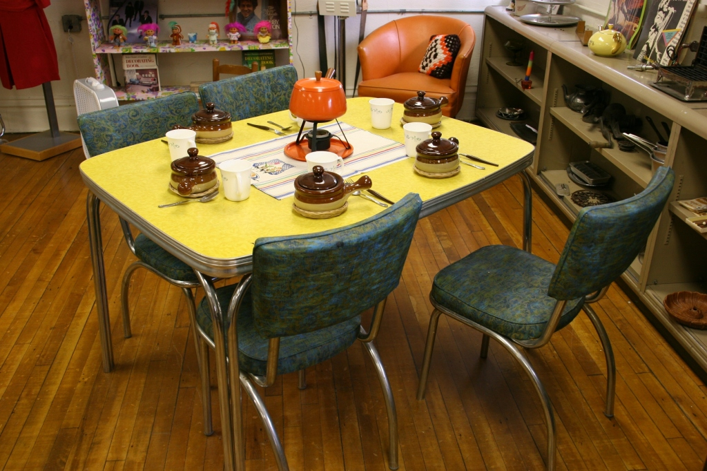 Growing up, I never was impressed by the oil-cloth covered Formica table in our kitchen. But today, well, I feel differently. My husband was especially thrilled to see this yellow table, like the one he remembers from his youth.