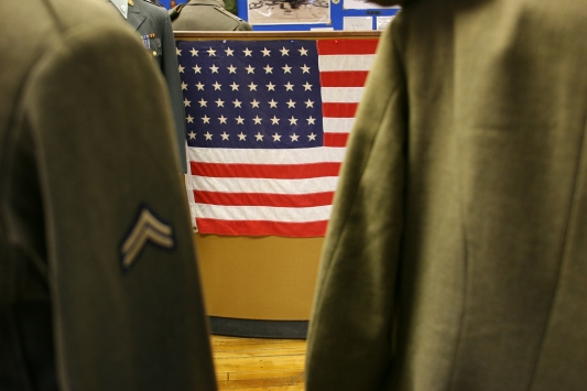 Between two military uniforms, I shot this view of a 48-star American flag.