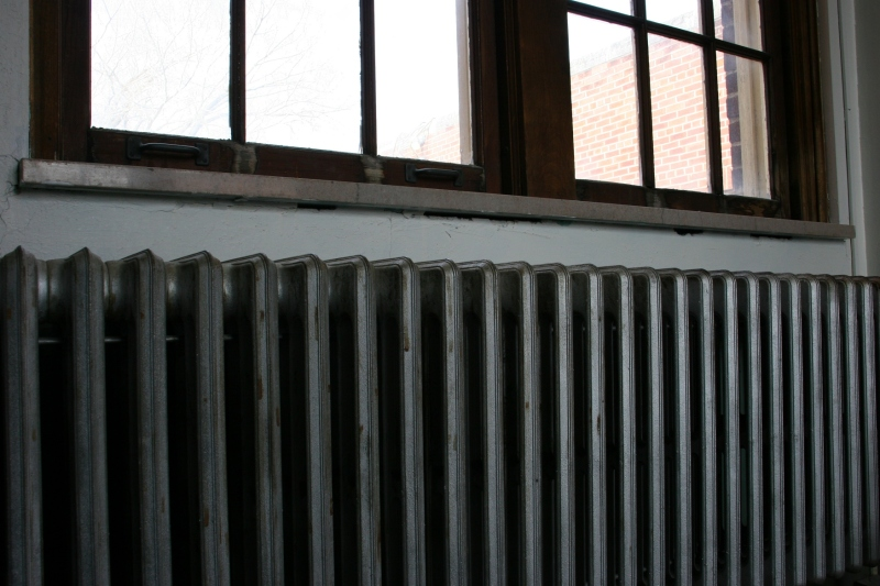 An old radiator and old windows.