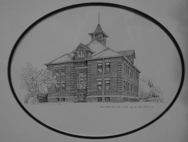 A drawing of the 1902 school hangs in a hallway.