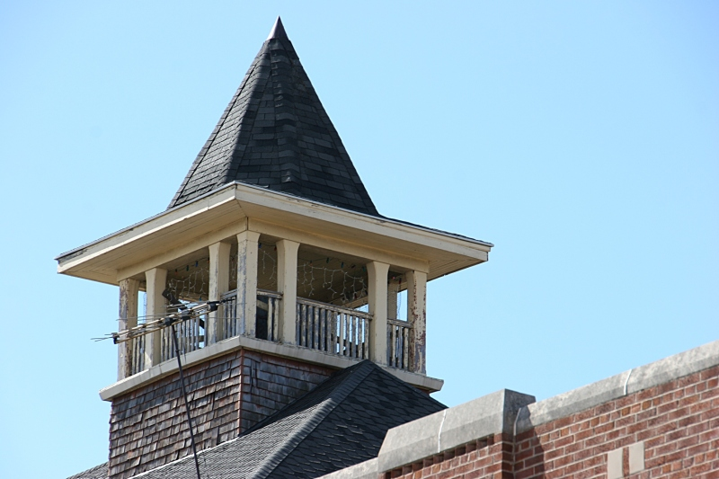 The roof of the aged school is topped with this unique architectural structure.