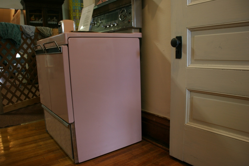 This pink Frigidaire electric stove was purchased by Arthur and Lorraine Spreiter in about 1959 from Pirkl and Hall Appliance along Main Street in West Concord. The stove features double oven doors rather than a drop-down door. The Spreiters also purchased an upright pink refrigerator/freezer.