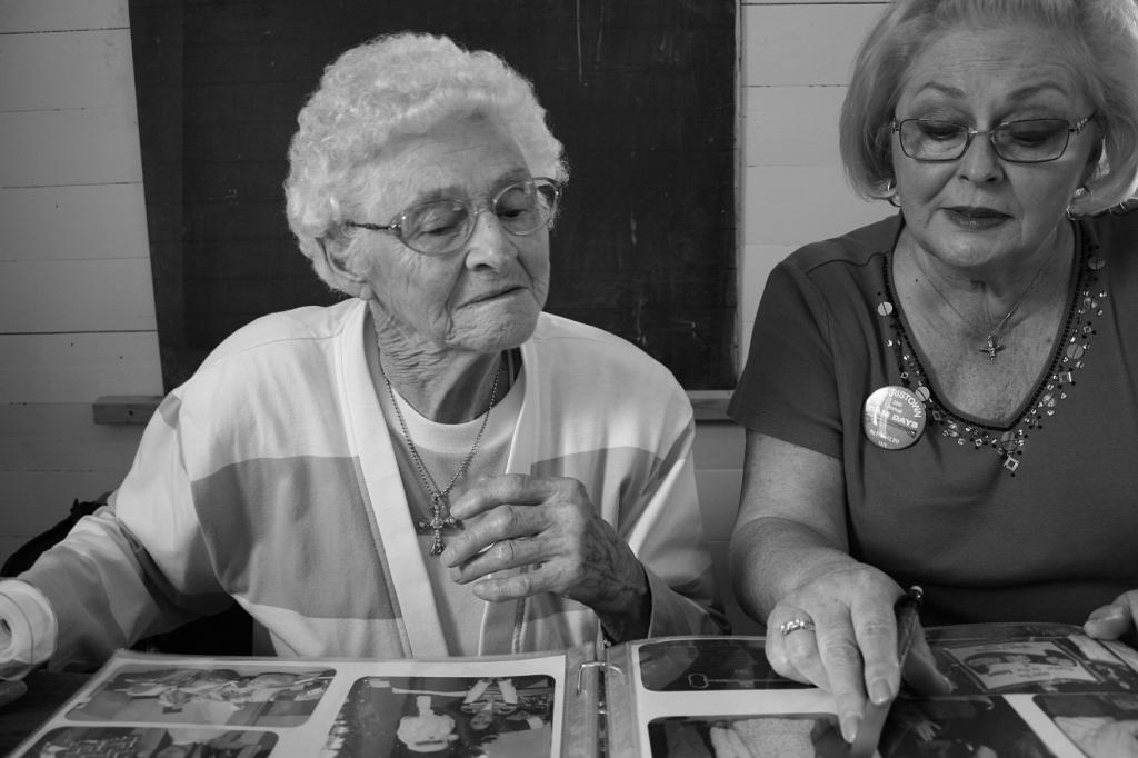 Helen Newman, left, and Cindy Packard work on a Morristown sesquicentennial scrapbook in June 2013.