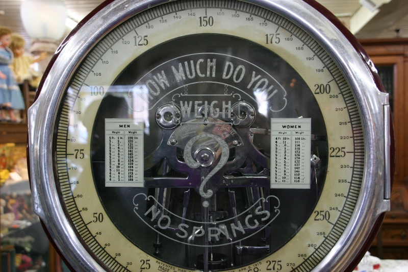 "One of Gordy Cariveau's favorite finds, and old scale which weighs accurate. According to charts on the scale, a 5'11"" man should weight 170 pounds, for example. And a 5'5"" woman, 132 pounds."