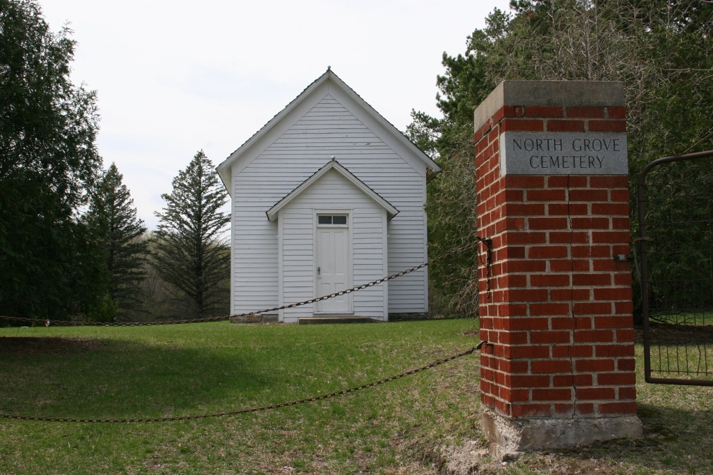 The entrance to North Grove Cemetery, which sits along Minnesota Highway 3 north of Faribault. The building once housed a church.
