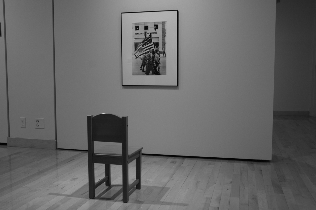 A chair placed before a Stephen Somerstein photo offers visitors a place to sit and contemplate.