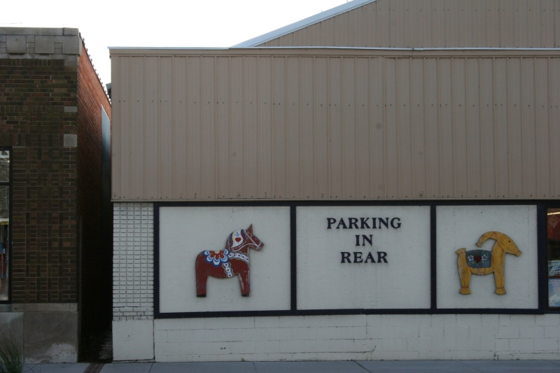 A Swedish dala horse and  Yule goat posted on a business honor this community's Swedish heritage.