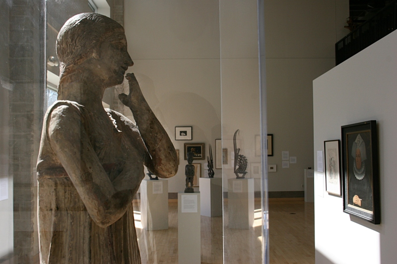 "The angle at which I photographed ""Archaic Greek Statue of a Woman"" makes it appear as if the Italian terra cotta sculpture is studying the art on display."