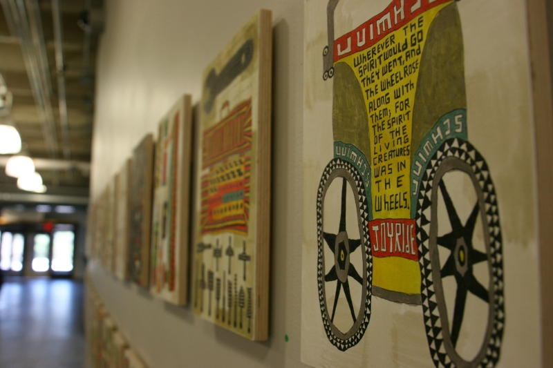 "Walking across the hall from one museum space to another, I found Michon Weeks' ""Wheel Within Wheel (#1-44) paintings hung along the atrium wall. The acrylic on paper on wood panel is a visual inventory of items in her Northfield garage."