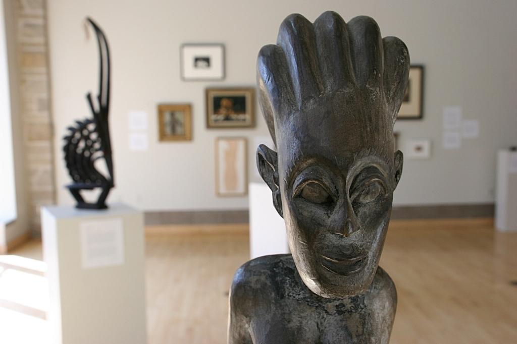 "A wood sculpture from Africa, artist unknown, and titled ""Seated Maternity Figure."""