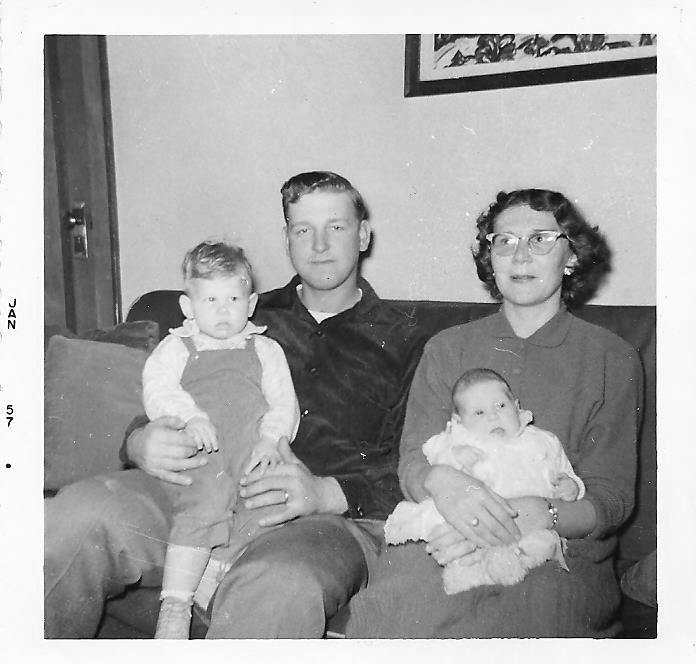 The only photo I have of my mom holding me. My dad is holding my brother Doug.